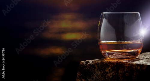 canvas print picture Whisky, whisky glass on the wooden table , banner