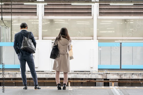 business woman and man stand on platform - 241926757