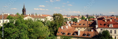 Prague's panorama, the capital city of Czech Republic, view over the roofs of the old city buildings - 241942590