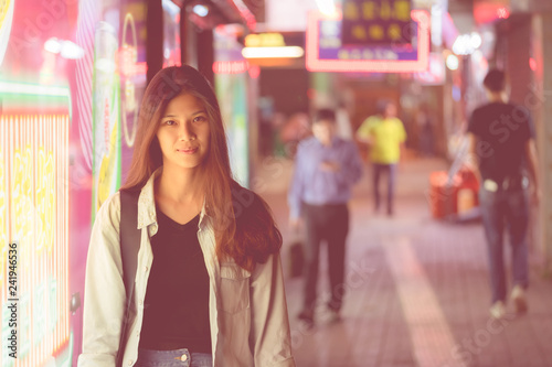 obraz lub plakat Cute Asian traveler girl in the night street of Hong Kong