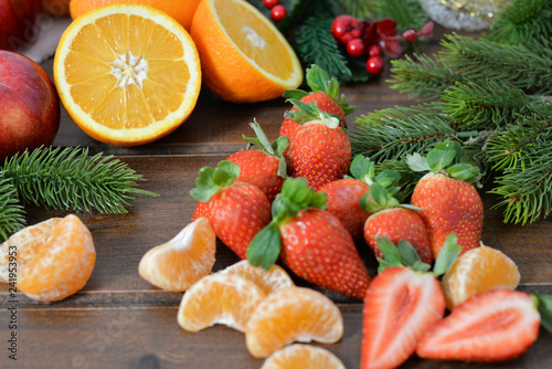 fruits on wooden background. Citrus fruits in rustic background ,oranges, strawberries , mandarins, clementines , apples . Healthy eating and dieting concept. Winter assortment