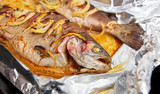 Fish baked in foil in the oven