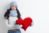 Woman with red heart shape pillow - 241961596