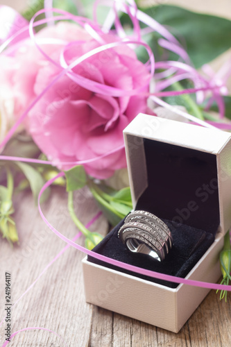 Silver ring with gems in white gift box