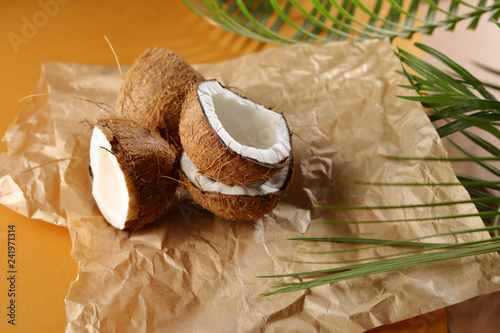 Fresh coconuts and green palm leaf - 241971314