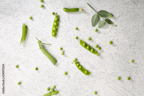 Green peas pod on white background