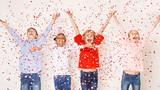 Happy children throwing confetti against light background - 241974518