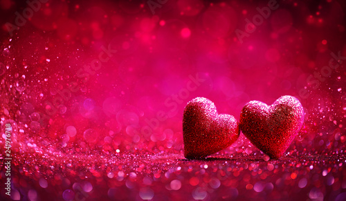 Leinwandbild Motiv Two Red Hearts In Shiny Background - Valentine's Day