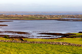 Farms in the Burren with Galway bay in background - 241983938