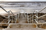 Stairs to the beach with rocks, sand and waves in Lahinch