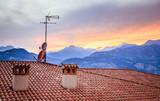 TV Antenna on the roof of an Italian house, Sunset