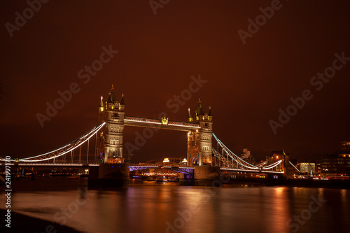Tower Bridge in London at night. - 241997170