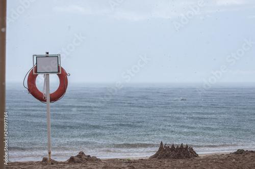 beautiful sea view, empty beach in rainy weather - 241997764
