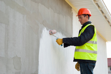 master paints the wall