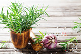 Fresh aromatic rosemary in mortar bowl for cooking. - 242001912