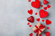 Valentines day background with gift box and red hearts.