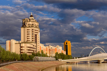 Multi-storey residential complex on the embankment in Astana, the capital of Kazakhstan © podgorakz