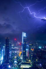 Night cityscape of guangzhou urban skyscrapers at storm with lightning  bolts in night purple blue sky, Guangzhou, China © lukyeee_nuttawut