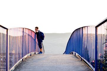 Sport wearing boy on the bridge.