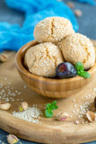 Homemade Moroccan sesame cookies in a wooden bowl. - 242019783