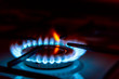 Leinwanddruck Bild - Blue gas burning from a kitchen gas stove. Selective focus