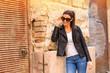 Fashion Portrait of a cheerful young woman in a european urban n