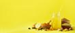 Leinwandbild Motiv Ingredients for orange turmeric drink on yellow background. Lemon water with ginger, curcuma, black pepper. Vegan hot drink concept