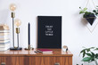 Leinwanddruck Bild - The retro mock up photo frame on the vintage wooden shelf , hanging plant in design pot, books, gold pyramid and table lamp. Concept of minimalistic shelfie.