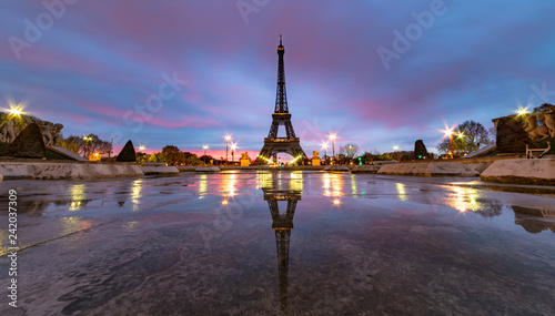 Sunrise on the Eiffel tower reflection on the Trocadero fountain water in Paris, one of the most visited building by the tourists