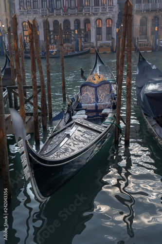 gondola prepared for a ceremony. Magnificent boat ready to parade in the canals of Venice - 242043356