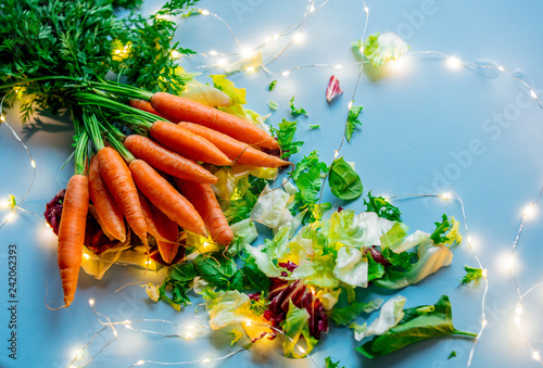 Foto Murales Fresh carrot with salad cabbage and fairy lights