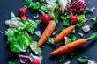 Three fresh carrots and salad with radish