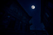 Leinwandbild Motiv Full moon over the ruins of old grunge building in Baku at night, house with balcony. Sovetsky, Azerbaijan