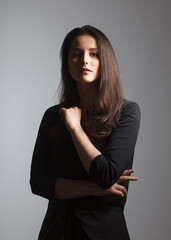 artistic moody portrait of young woman on studio background © Schum