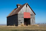 Old wooden barn in the rural open farmland.  Illinois, USA - 242071596