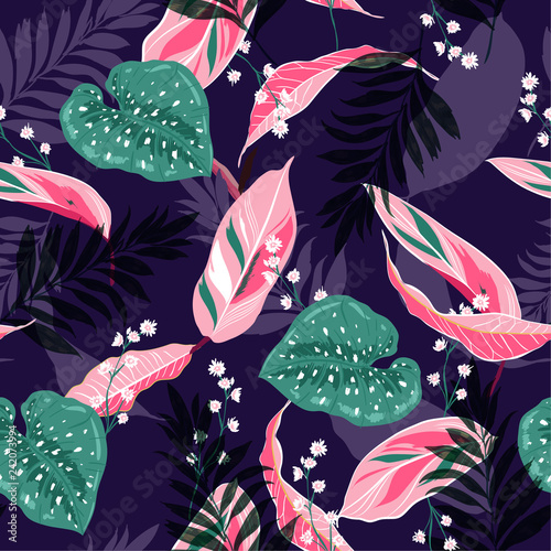 Beautiful dark tropical leaves. Seamless graphic design with palms leaves and flowers. Fashion,fabric and all prints
