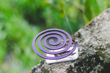 Insect repellent mosquito coil incense smoking. - 242080726