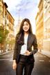 Smiling asian business woman walking