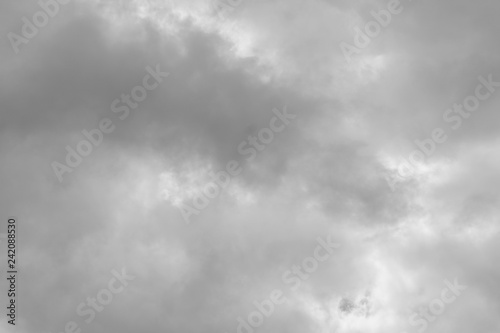 black and white sky with white and gray clouds