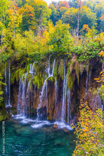 Waterfalls are reflected in the lake - 242097198