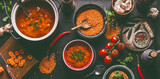 Red lentil soup with cooking ingredients on dark rustic kitchen table background, top view. Healthy vegan food concept. Vegetarian lentil meal dishes. Clean eating. - 242115365
