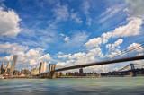 Brooklyn bridge, Hudson river and the island of Manhattan, New York skyline, USA
