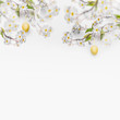 Spring blossom branches with hanging yellow Easter eggs at white wall background, banner. Fresh modern decorative concept. Easter background with copy space