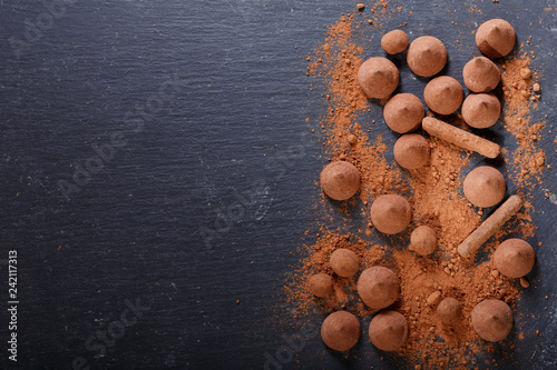 obraz lub plakat chocolate truffles candies on dark background