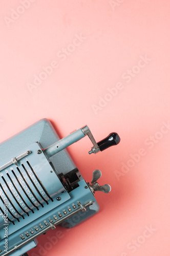 Old counting machine on pink background - 242121910