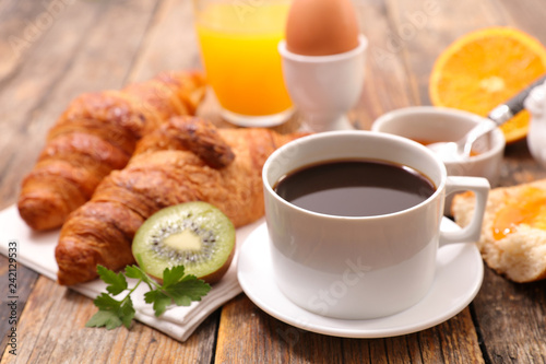 coffee with croissant and egg - 242129533
