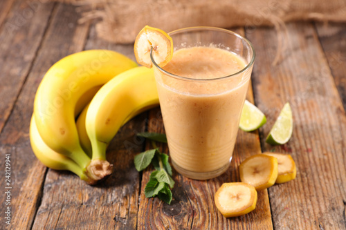 banana smoothie on wood background © M.studio