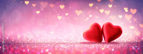 Two Hearts On Pink Glitter In Shiny Background - Valentine's Day Concept  - 242134331