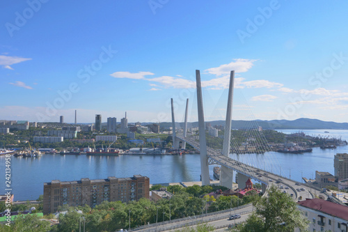 Golden bridge of Vladivostok seascape overlooking the landmark of the city image in Vladivostok Russia