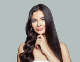 Young beautiful woman with straight and curly hairstyle. Hair styling and hair care concept. Young brunette woman